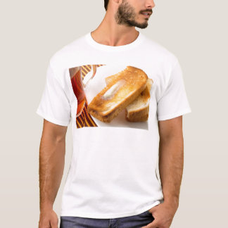 Hot toast with butter on a white plate close-up T-Shirt