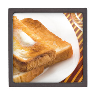 Hot toast with butter on a white plate keepsake box