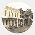 Hotel del pueblo fantasma del vintage etiqueta redonda