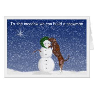 Houla y tarjeta de Navidad del muñeco de nieve