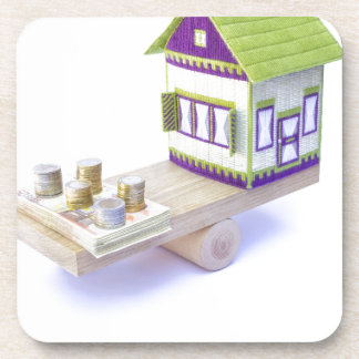 House in balance with pile of euro coins and notes coaster