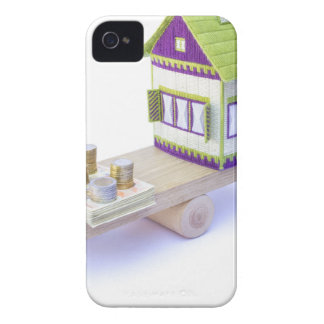 House in balance with pile of euro coins and notes iPhone 4 Case-Mate case