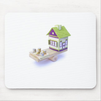 House in balance with pile of euro coins and notes mouse pad