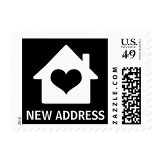 House on black background change of address postage