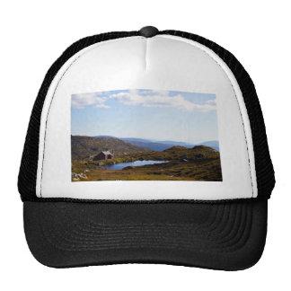 House on hill trucker hat