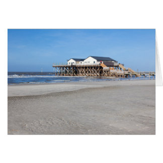 House on stilts at the beach of St. Peter Ording Card