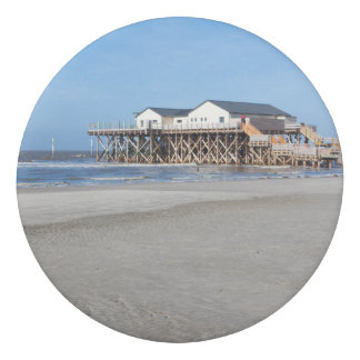 House on stilts at the beach of St. Peter Ording Eraser