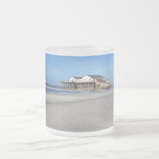 House on stilts at the beach of St. Peter Ording Frosted Glass Coffee Mug