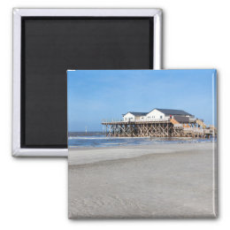 House on stilts at the beach of St. Peter Ording Magnet