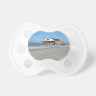 House on stilts at the beach of St. Peter Ording Pacifier