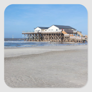 House on stilts at the beach of St. Peter Ording Square Sticker