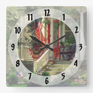 House With Bunting and Flag Square Wall Clock