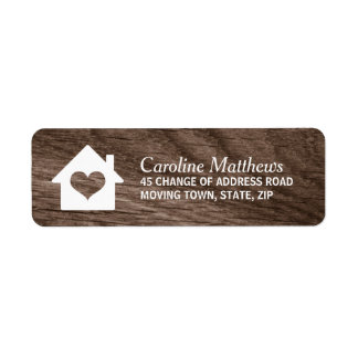 House with heart on elegant wood label
