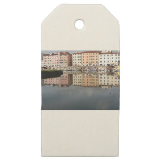 Houses and boats are reflected in the water wooden gift tags