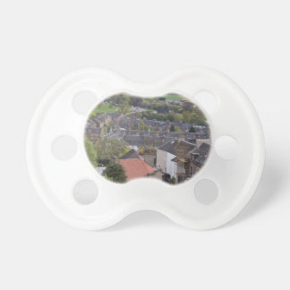 Houses and meadows as seen from a height pacifiers