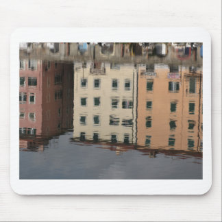 Houses are reflected in the tranquil water mouse pad