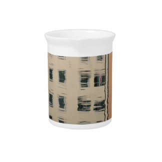 Houses are reflected in the tranquil water pitcher