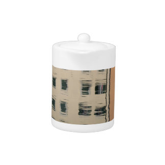 Houses are reflected in the tranquil water teapot