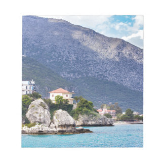 Houses rocks and mountain at greek sea notepad