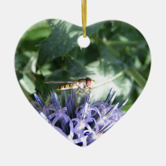 Hover fly on a purple flower ceramic ornament