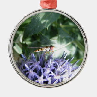 Hover fly on a purple flower metal ornament