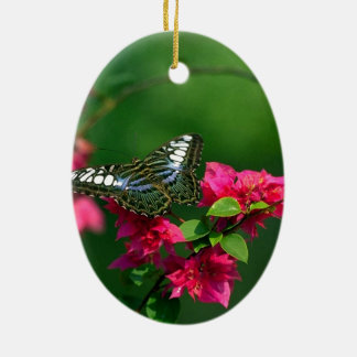 Hovering butterfly on a pink flower ceramic ornament