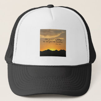 How glorious a greeting the sun gives the mountain trucker hat