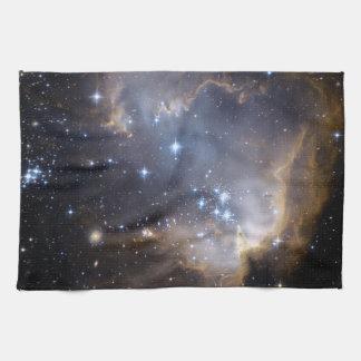 Hubble observa las estrellas infantiles en galaxia toalla de mano