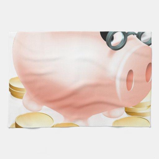 Hucha de la pensión con las monedas toalla de cocina