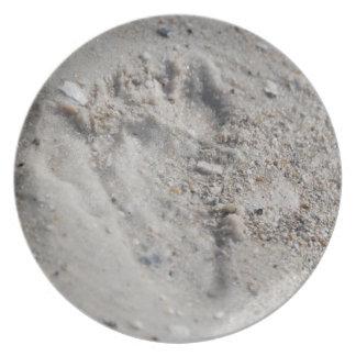Huella en la placa de la arena platos