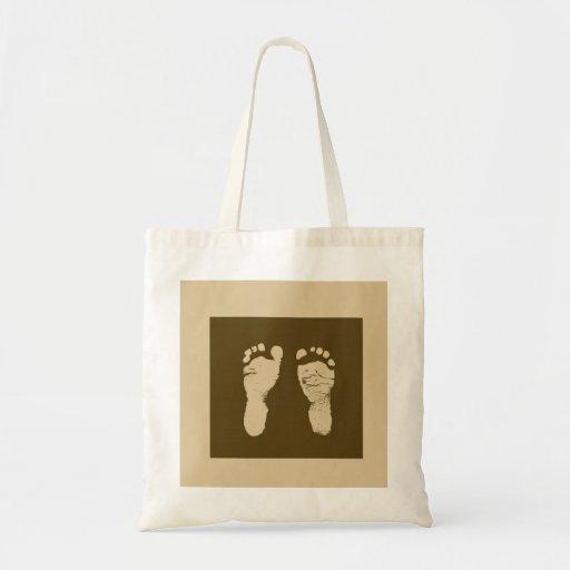 Huellas del bebé bolsas de mano