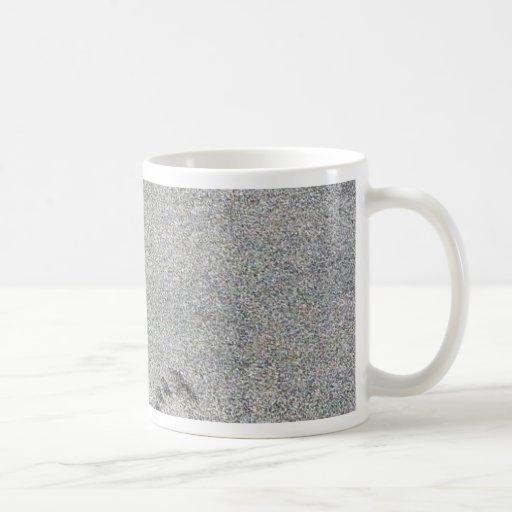 Huellas en arena taza