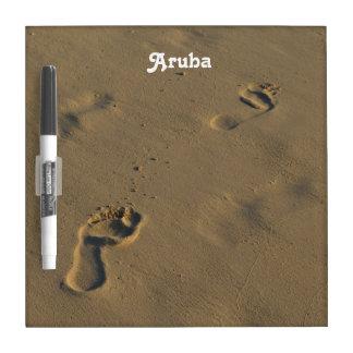 Huellas en la arena tablero blanco