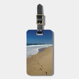 Huellas en la playa, Mabibi, Thongaland Etiquetas Maleta