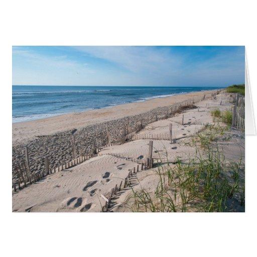 Huellas en la tarjeta de la historia de la arena