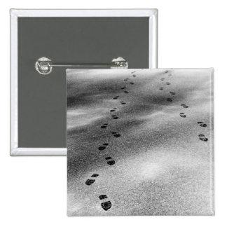Huellas en nieve pin cuadrado