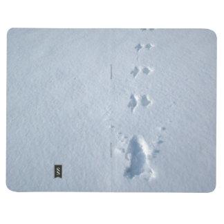 Huellas salvajes del pájaro en nieve cuadernos