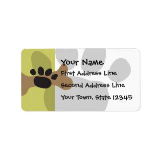 Hueso de perro y impresión de la pata etiqueta de dirección