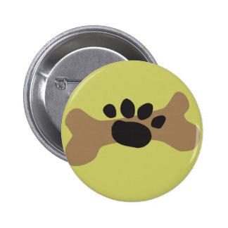 Hueso de perro y impresión de la pata pin