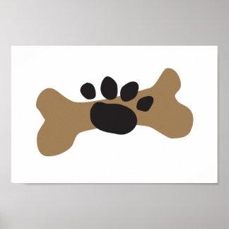 Hueso de perro y impresión de la pata póster