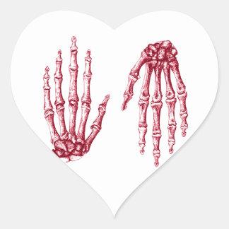 Huesos de mano pegatina en forma de corazón