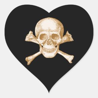 Huesos del cráneo y de la cruz en naranja pegatina en forma de corazón