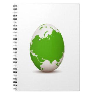 huevo blanco verde del globo formado con shadow.pn libros de apuntes con espiral