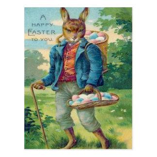 Huevo coloreado cesta del conejito de pascua tarjeta postal