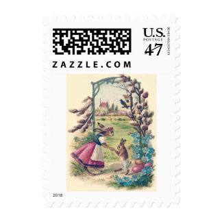 Huevo coloreado niño de la mamá del conejito de sellos postales