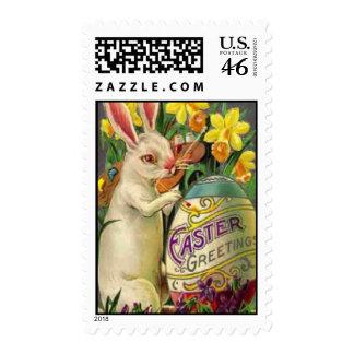 Huevo de la pintura del conejito de pascua sellos