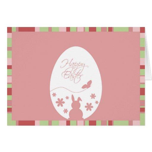 Huevo de Pascua en un fondo rosado - tarjeta de fe