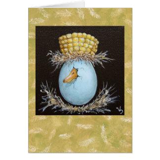 huevo del pato silvestre con la tarjeta del gorra