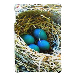 Huevos de los petirrojos en caso de Ipad de la fot