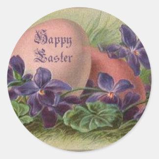 Huevos de Pascua entre las violetas Pegatina Redonda